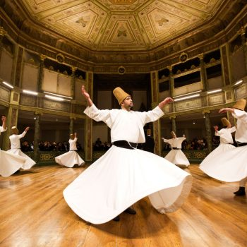 TOPSHOTS TOPSHOTS__Whirling dervishes perform at the Galata Mevlevihane (The Lodge of the Dervishes) in Istanbul on December 18, 2013. The dervishes are adepts of Sufism, a mystical form of Islam that preaches tolerance and a search for understanding. Those who whirl, like planets around the sun, turn dance into a form of prayer.   AFP PHOTO/GURCAN OZTURKGURCAN OZTURK/AFP/Getty Images